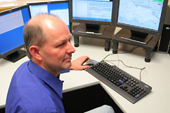 Tait support staff member working on his computer